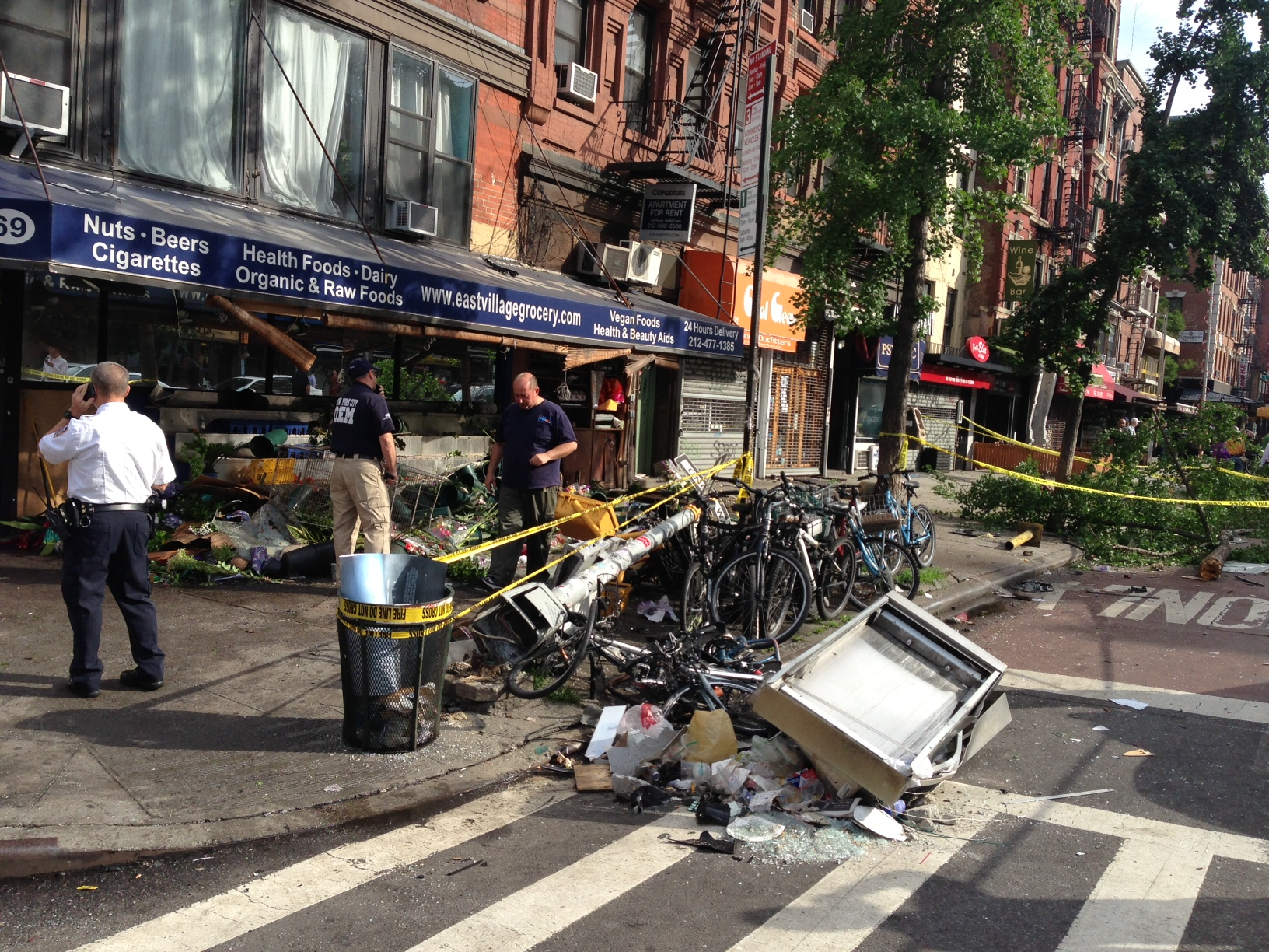 Car Jumps Curb and Plows Through Bodega Flower Stand, Injuring Eight