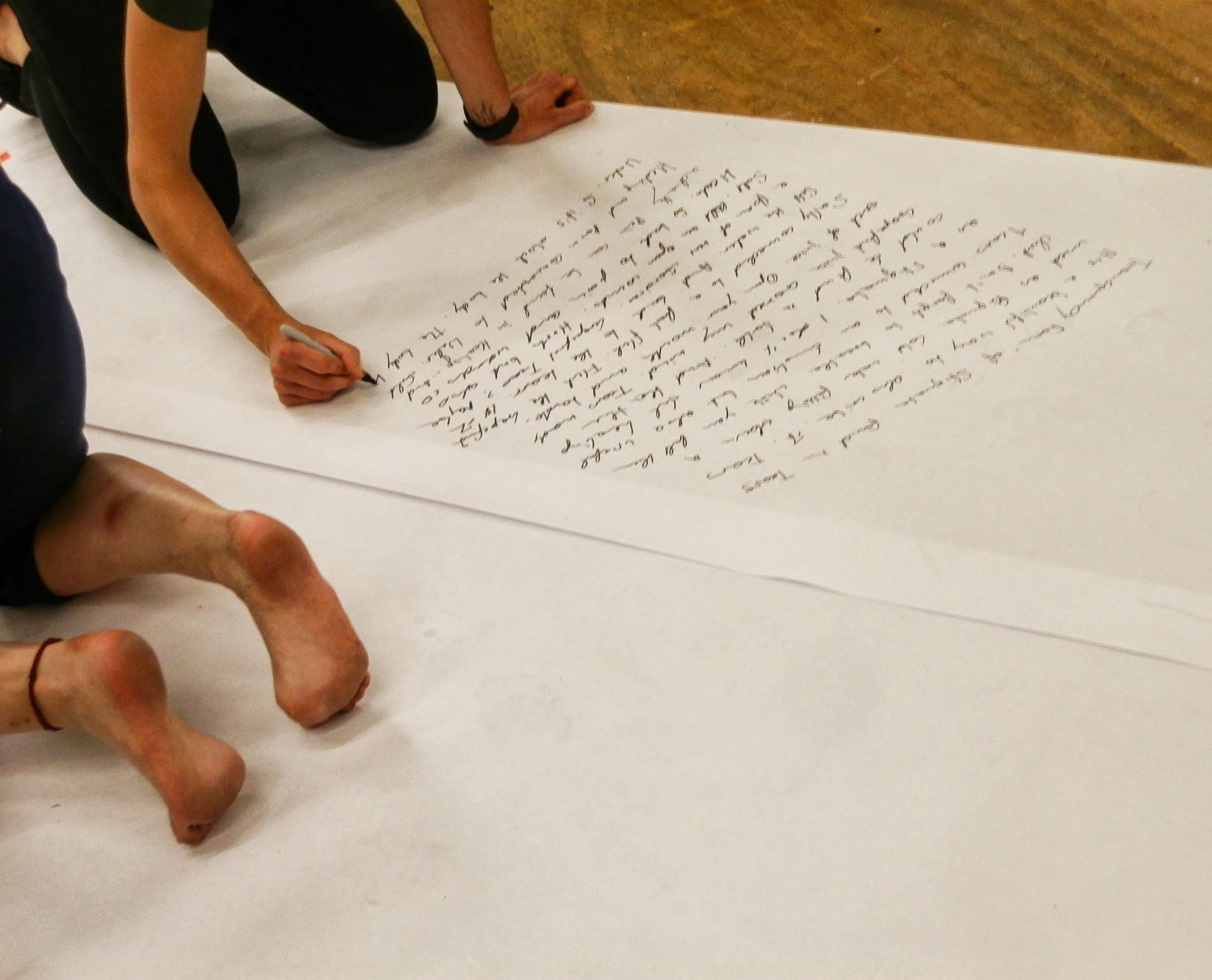 Automatic writing in process. (Photo: Emily Colucci)