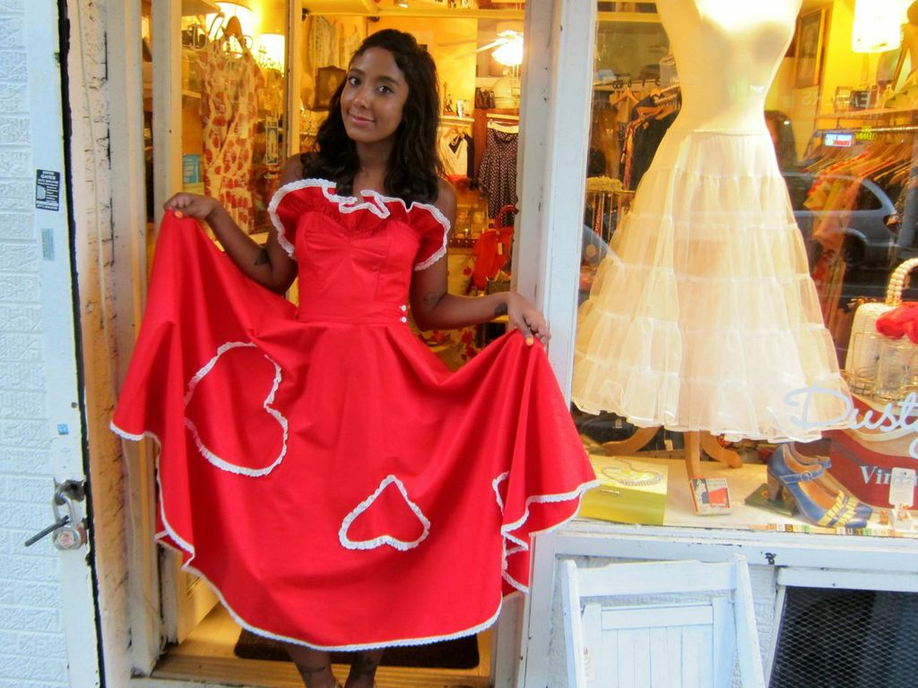 "Annette passes over the '50s-era bustier top and matching circle skirt in the front window display, which looks like a Valentine-themed flamenco costume, but relentlessly helpful Amanda encourages her to try it on anyway.  ""I feel like Lolita,"" she says."