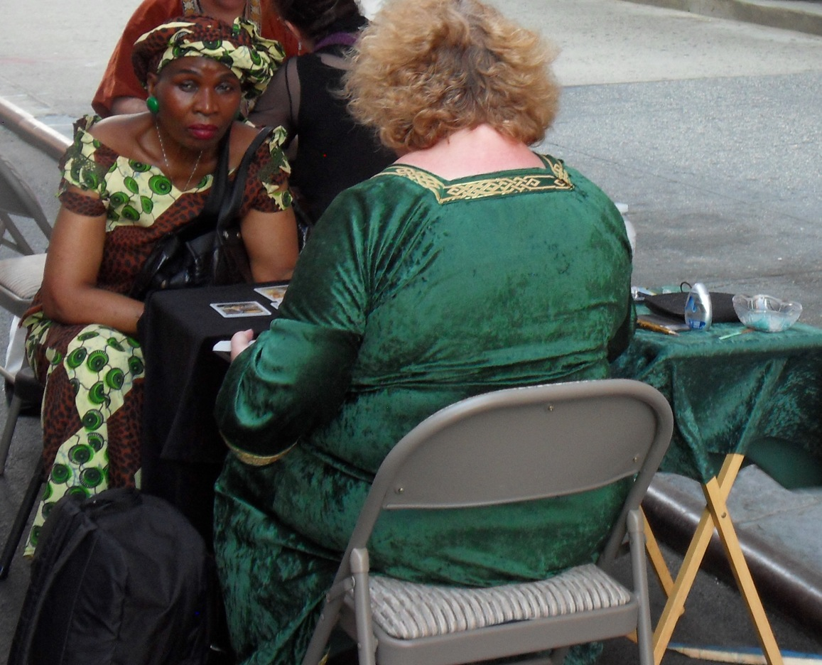 A woman receiving a tarot reading from reader, Charlotte Lee.