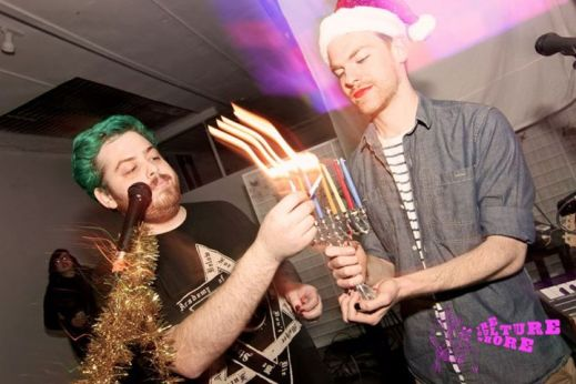 Mark Dommu lighting the menorah at the Dick the Balls with Loads of Molly party. (photo: The Culture Whore)