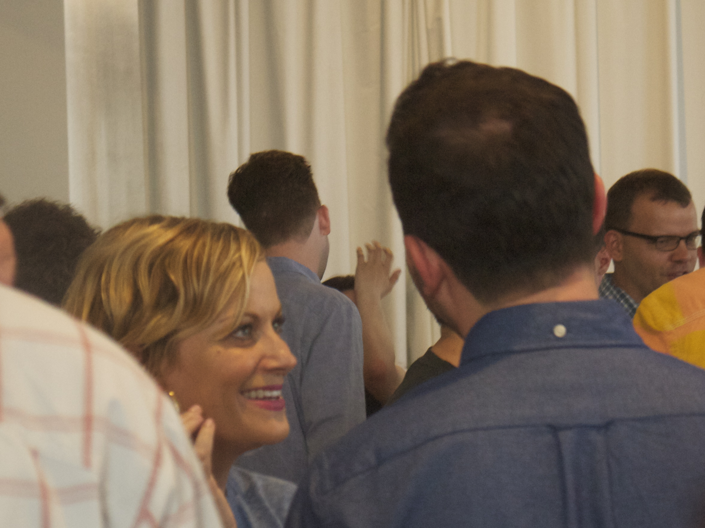 Our best paparazzi shot of new beaus Amy Poehler and Nick Kroll