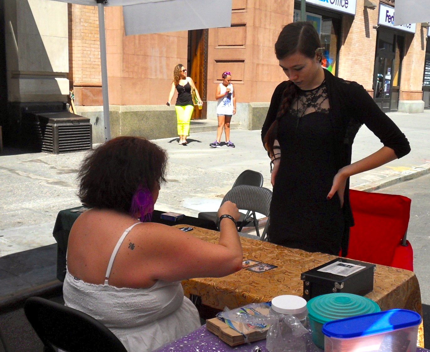 A woman receives a reading at one of the festival's many booths.