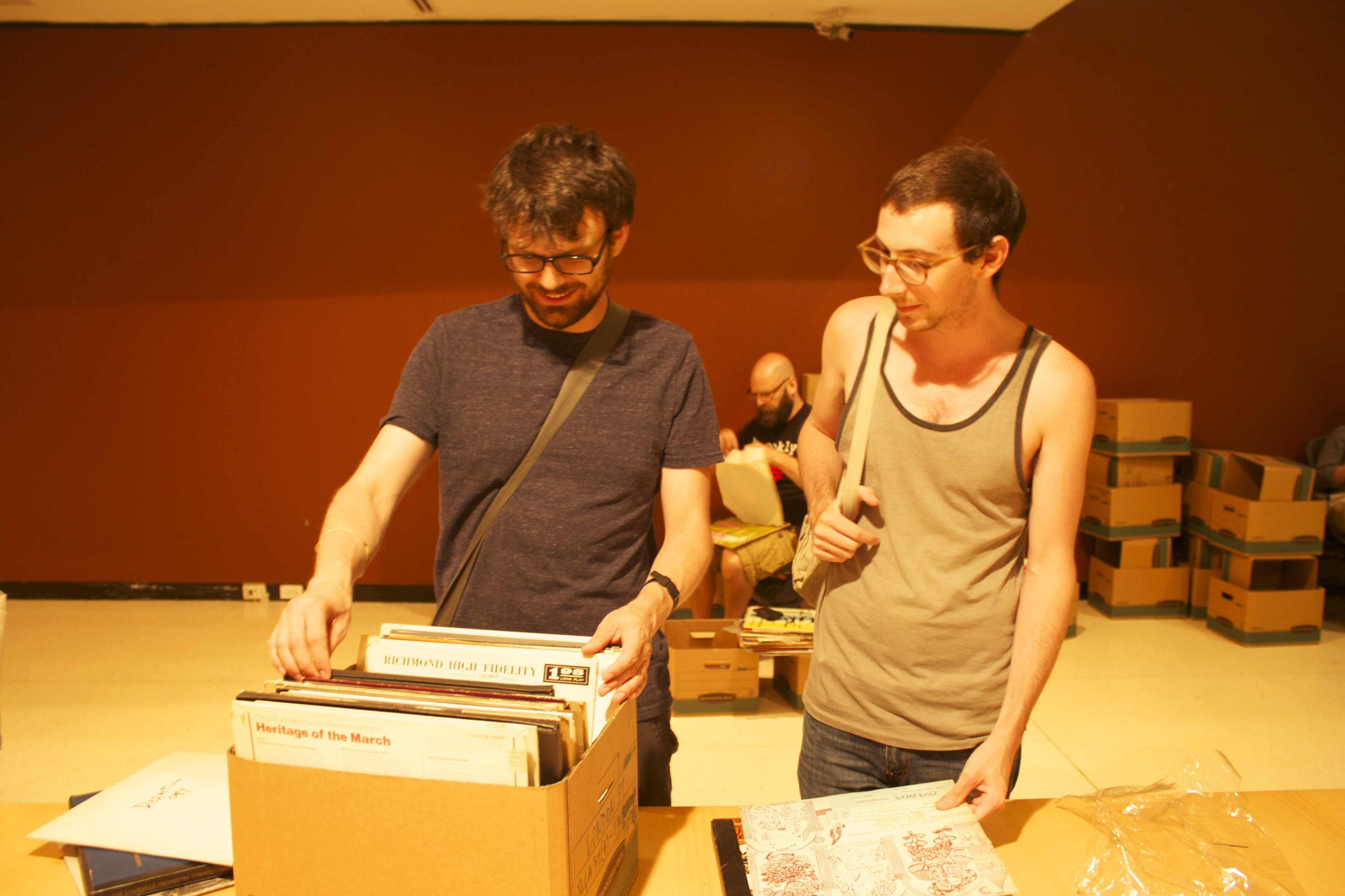 Matthew Gantt and Joe White flip through the stacks.
