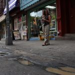 Julia amidst the mystery puddles of Broome Street.