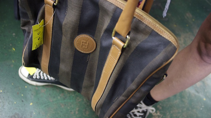 "The purse she chose, which has a Fendi logo and cost more than twice as much as all the other bags, sparked a great debate and examination of stitching quality. ""It's got to be fake. But they are charging $30 because they think it's real,"" she said. ""But what's wrong with a fake Fendi?"""