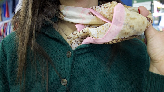 "Shira took one look at the scarf rack, and grabbed one made of speckled pink-and-brown chiffon. ""I like the color pink, and it feminizes the outfit,"" she said. ""Otherwise, I'd look like a 12 year-old boy."""