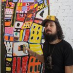 Adam Green in front of one of his paintings (Photo: Anna Silman)