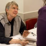 "Lois Lowry signs a copy of ""The Giver"" for a fan after a panel. The acclaimed children's book author received the Brooklyn Book Festival's ""BoBi"" award for her work. (Photo: Meghan White)"