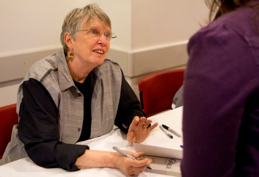 Lois Lowry signs a copy of