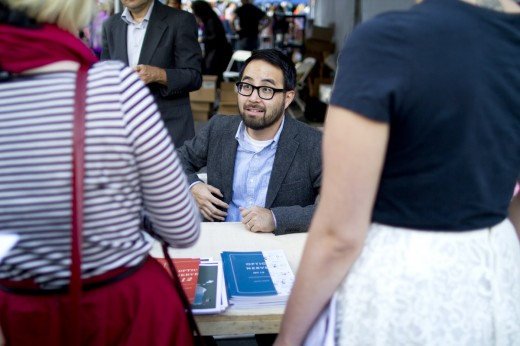 Cartoonist Adrian Tomine signs copies of his series Optic Nerve. (Photo: Meghan White)