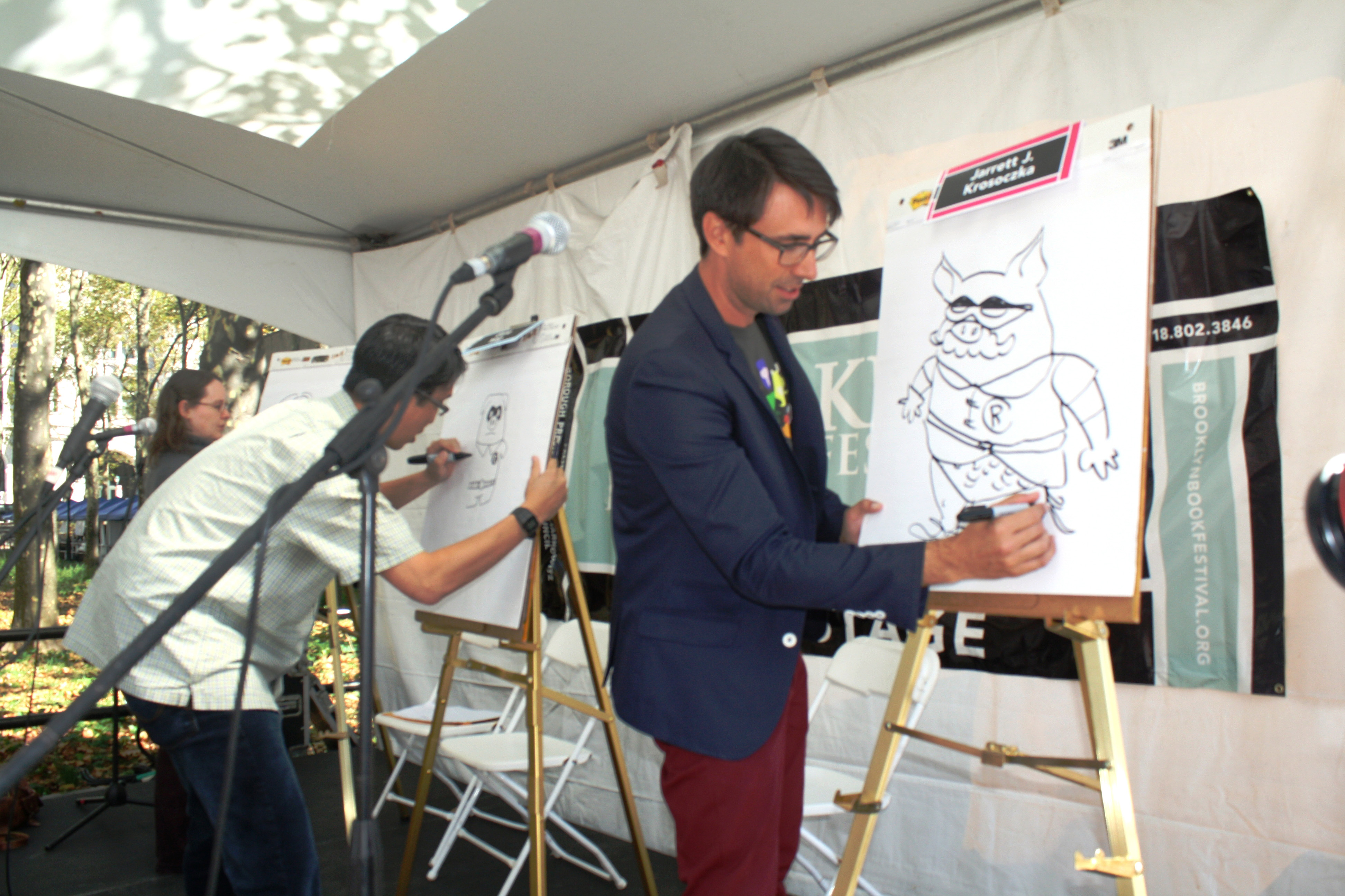 Children's cartoonists Jarrett Krosoczka, Gene Yang and Raina Telgemeier in the Comic Quick Draw for kids (Photo: Saranya Kapur)