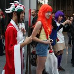 The woman on the right appears to be a long-haired Misty from Pokemon. The masked woman in the kimono is a mystery.