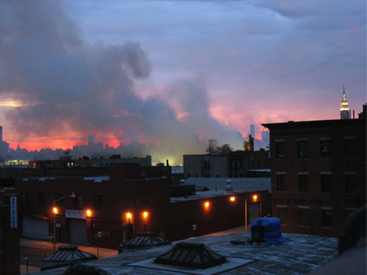 The sun sets over Brooklyn as the fire at the Greenpoint Terminal still burns. (Flickr/RobotPolisher)