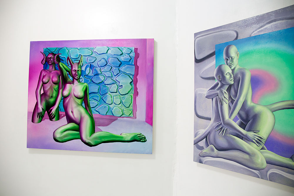"""Paintings by Emma Stern, left: """"Fauns (Horned Gals in Pink Room)"""" right: """"The Body Politic (two fauns embracing)"""" 2016 (Photo: Nicole Disser)"""