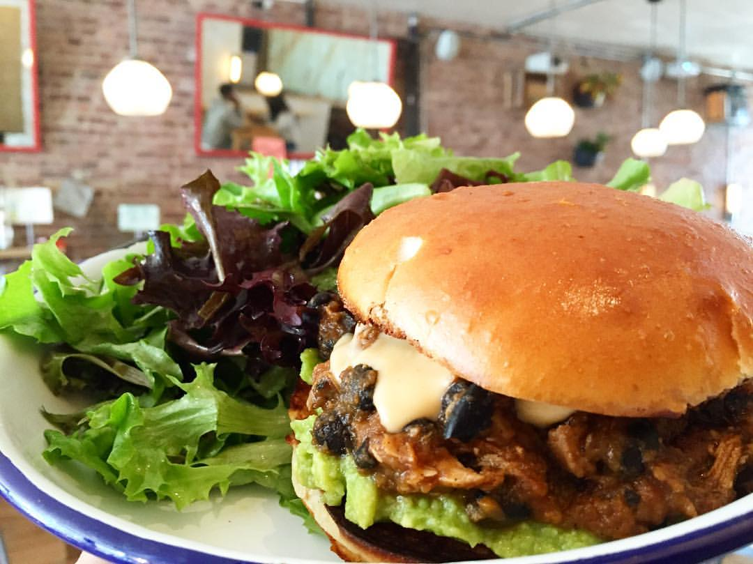 A Sloppy Poppy special with braised chicken, black beans, smashed avocado and queso. (Photo courtesy Father Knows Best)