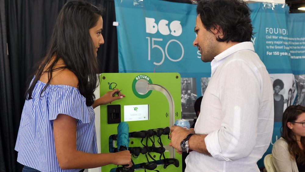 'brellaBox Co-Founder Anusha Kambhampaty demonstrates the umbrella rental vending machine. (Photo: Karissa Gall)