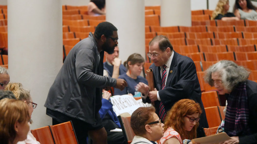 Congressman Jerrold Nadler (right), one of 6 elected officials who testified, shakes hands in the crowd after urging RGB to enact a rent rollback. (Photo: Karissa Gall)