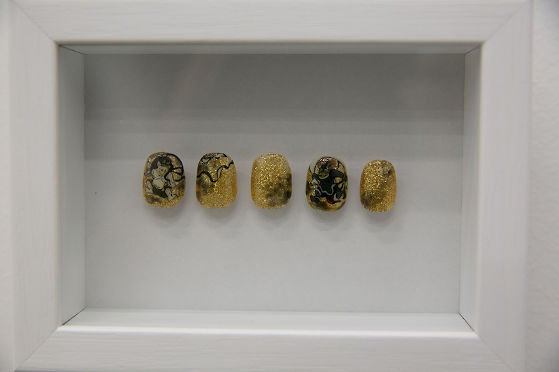 Yuki Okamoto's collection of nail art consisted of very intricate paintings on fake nails.