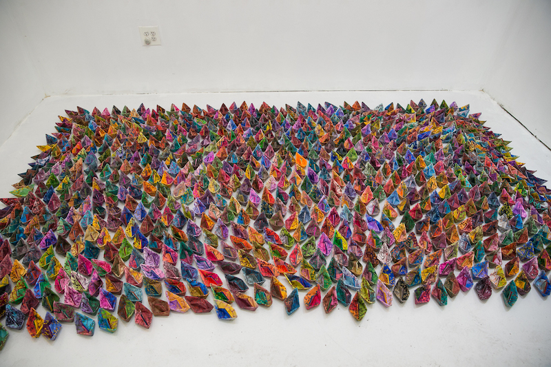 Mona Kamal made over 200 origami boats.