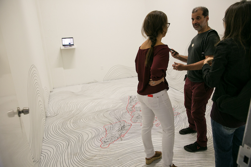 Claudia Vieira used masking tape to make one continuous line, over 2,700 feet long