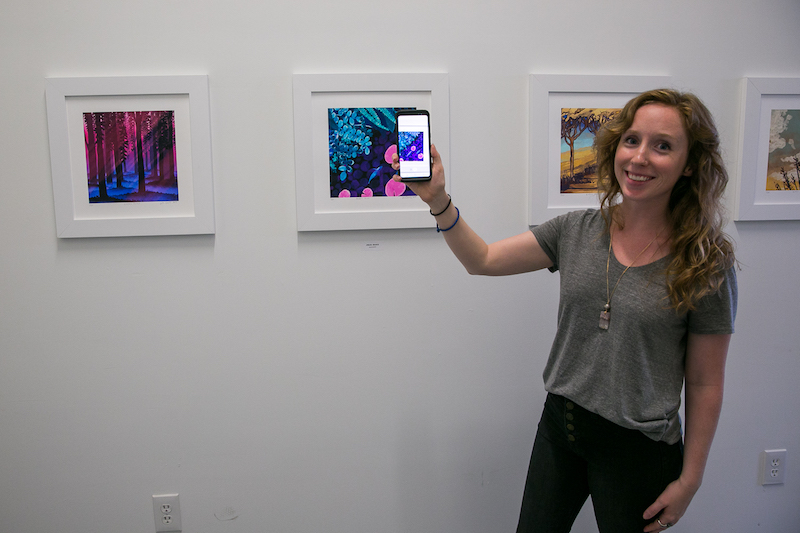 Animator Julie Gratz created augmented reality prints. Holding an app in front of the image showed a full animation of the print with sound.