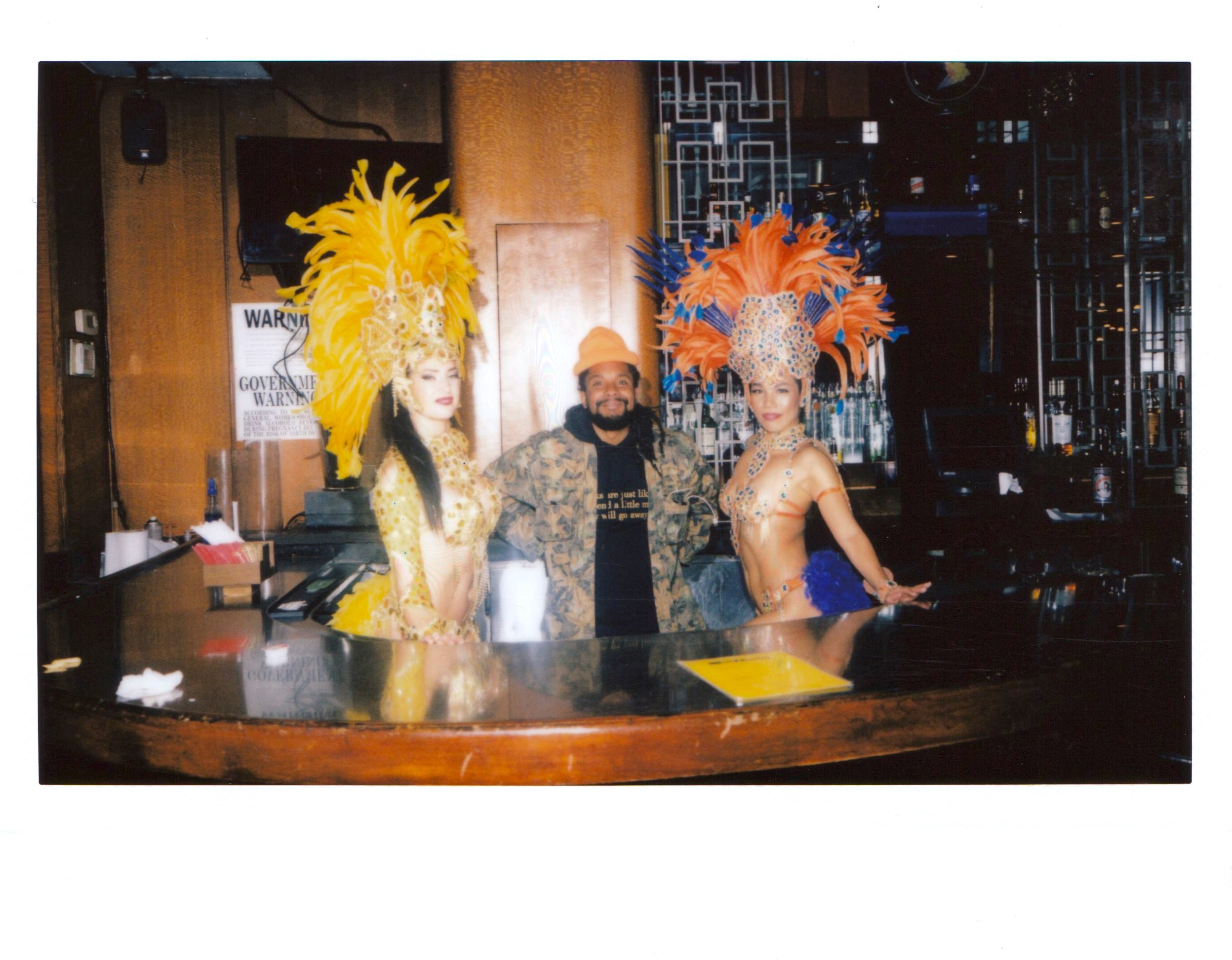 Artists O.J. Jimenez with the carnival dancers behind Coffee Shop's rear bar.